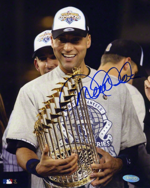 Derek Jeter Autographed Photograph  Details: New York Yankees, 8x10, Holding 2009 World Series Memorial of conquest