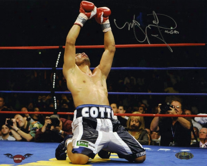 Miguel Cotto - On Knees Celebration - Autographed 8x10 Photograph